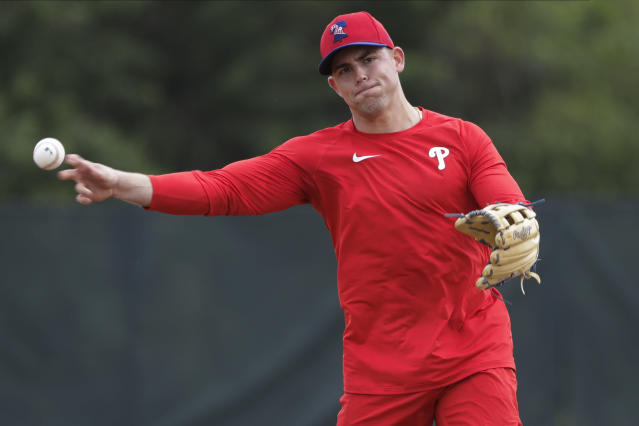 Philadelphia Phillies Scott Kingery takes part in drills during a spring training baseball workout Friday, Feb. 14, 2020, in Clearwater, Fla. (AP Photo/Frank Franklin II)