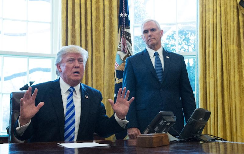 "Pence and his staff have worked hard not to eclipse Trump or show any hint of difference with him, with one senior aide saying ""the vice president's role, other than being the president of the Senate, is 100 percent defined by the president"" (AFP Photo/MANDEL NGAN)"