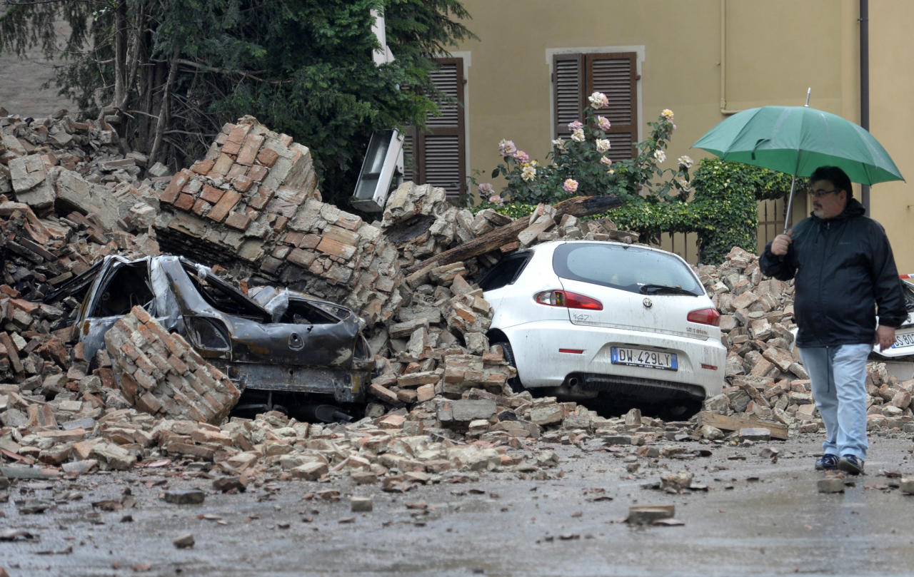 A man looks at the damage caused by a quake in Finale Emilia northern Italy, Sunday, May 20. 2012. An earthquake shook northern Italy early Sunday at 4:04 a.m. Sunday between Modena and Mantova, about 35 kilometers (22 miles) north of Bologna at a relatively shallow depth of 10 kilometers (6 miles). (AP Photo/Marco Vasini)