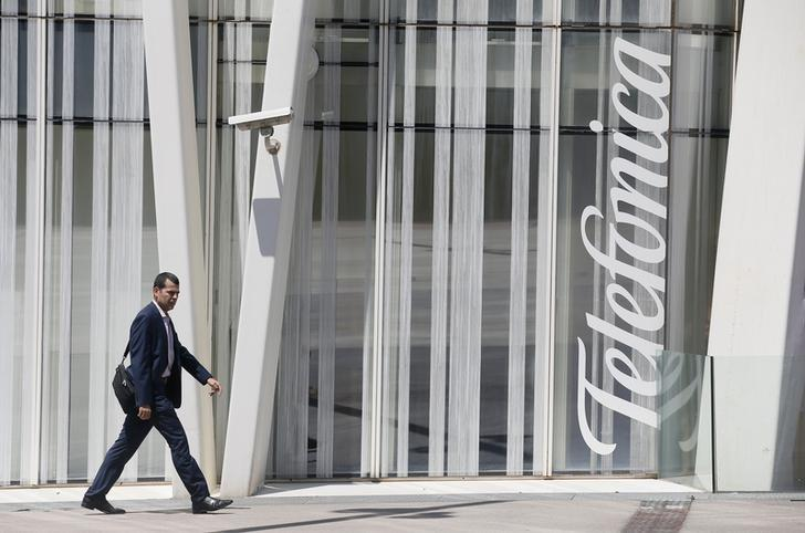 A man walks past a Telefonica building in Barcelona