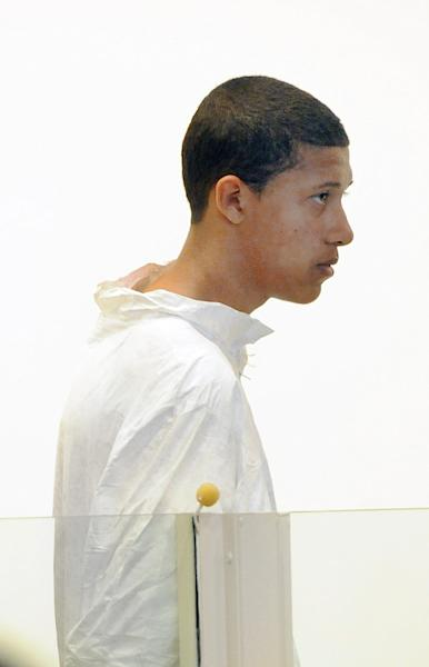 Philip Chism, 14, stands during his arraignment for the death of Danvers High School teacher Colleen Ritzer in Salem District Court in Salem, Mass., Wednesday, Oct. 23, 2013. Chism has been ordered held without bail. (AP Photo/Boston Herald, Patrick Whittemore) MANDATORY CREDIT