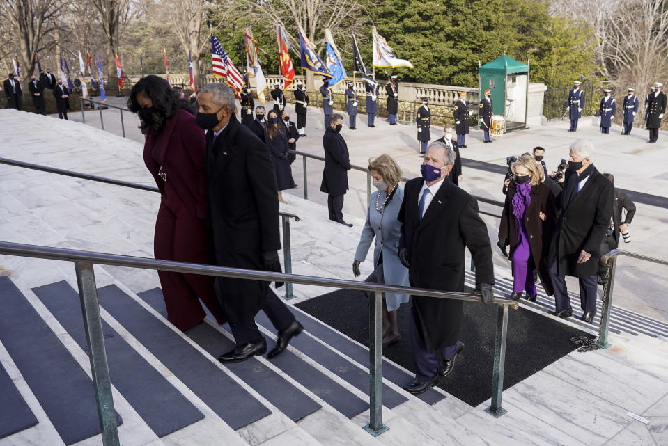 Bill Clinton with wife, former Secretary of State, Hillary Clinton, George W. Bush with his wife Laura Bush, Barack Obama and his wife Michelle Obama walk up stairs behind each other