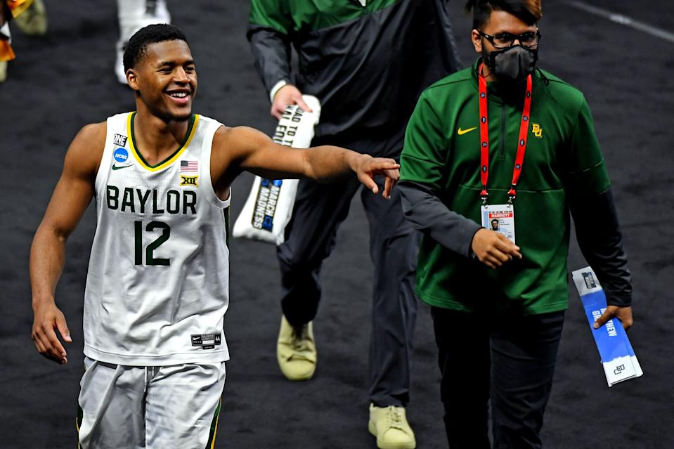 Baylor Bears guard Jared Butler (12) celebrate after beating the Hartford Hawks in the first round of the 2021 NCAA Tournament at Lucas Oil Stadium.