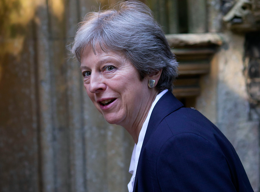 <em>The Prime Minister's grip on her leadership has been weakened by the resignation (Rex)</em>
