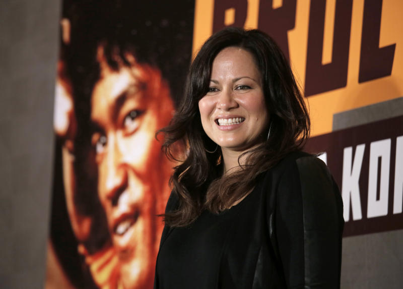 "Shannon Lee, daughter of Bruce Lee and president of the ""Bruce Lee Foundation, poses for photographers during a press conference launching instant drinks in her father's name in Hong Kong, Monday, Nov. 24, 2014. (AP Photo/Vincent Yu)"
