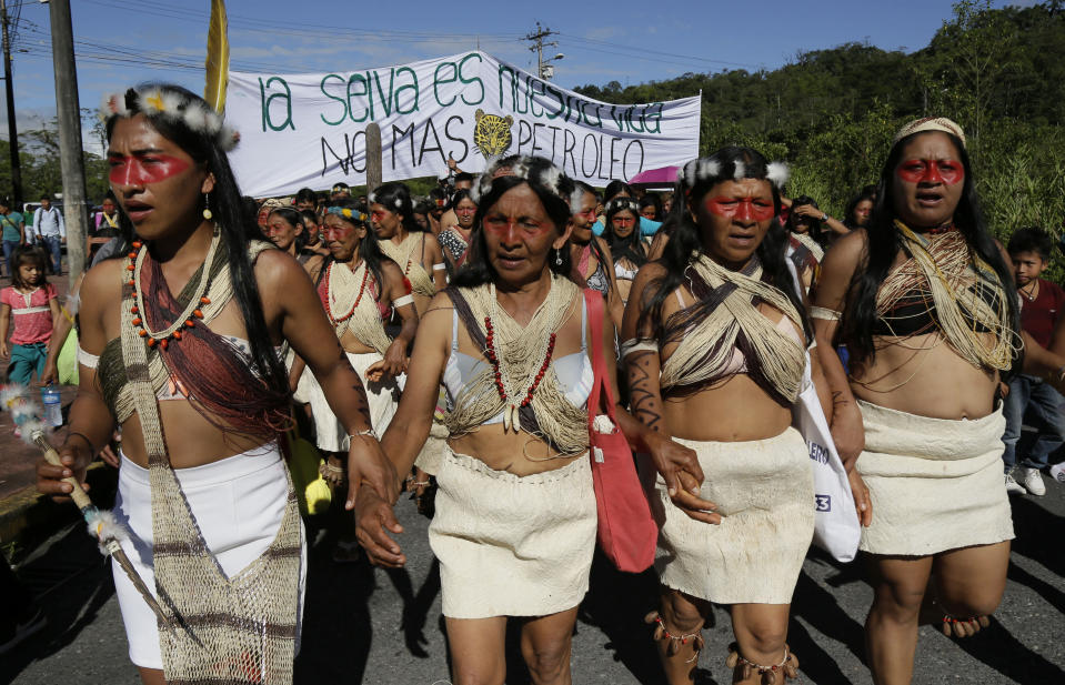 Waoranis march to a courthouse to attend the ruling on a lawsuit filed by the Waoranis against the Ministry of Non-Renewable Natural Resources for opening up oil concessions on their ancestral land, in Puyo, Ecuador, Friday, April 26, 2019. The judge went on to rule in favor of the Waoranis. (AP Photo/Dolores Ochoa)