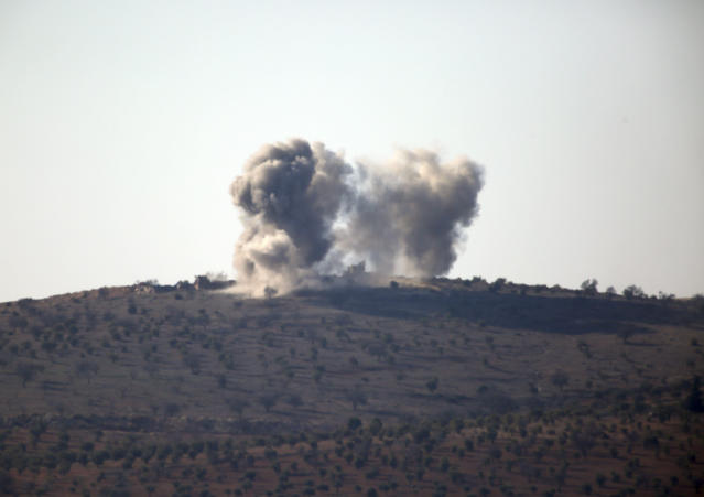 <p>Smoke rises in the air from Turkish forces shelling inside Syria, as seen from the outskirts of the town of Kilis, Turkey, Tuesday, Jan. 30, 2018. (Photo: Lefteris Pitarakis/AP) </p>