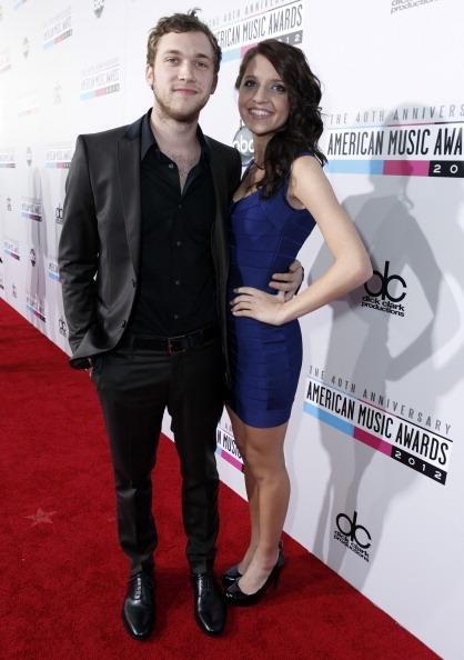 Phillip Phillips and Hannah Blackwell arrive on the 2012 American Music Awards red carpet.