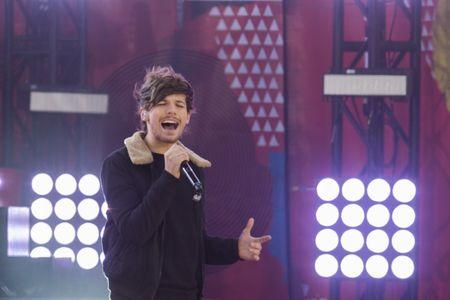 Singer Louis Tomlinson of the band One Direction performs on ABC's Good Morning America inside Central Park in New York