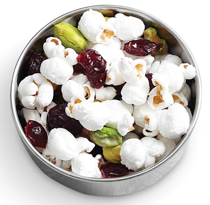"<p>Popcorn is a whole grain and the nuts add healthy fats. Look for dried cherries or cranberries sweetened with fruit juice or choose an unsweetened fruit like raisins. <a href=""http://www.eatingwell.com/recipes/fruit_nut_popcorn_trail_mix.html?utm_source=YahooBlog_BradyDiet_011316h""><b>Try the <b>Fruit & Nut Popcorn Mix</b> recipe.</b></a></p>"