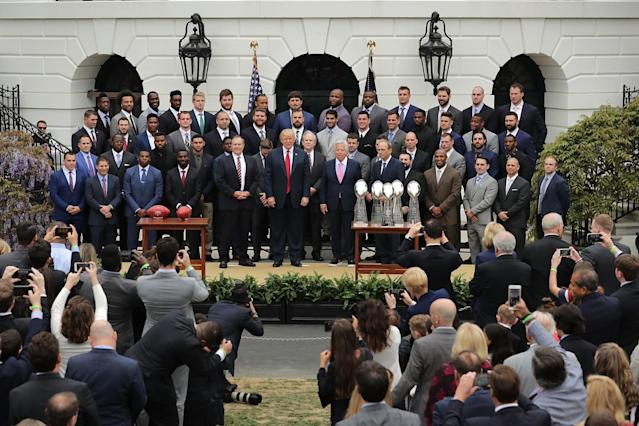 <p>President Donald Trump poses for photographs with the New England Patriots during a celebration of the team's Super Bowl victory on the South Lawn at the White House April 19, 2017 in Washington, DC. It was the team's fifth Super Bowl victory since 1960. (Photo by Chip Somodevilla/Getty Images) </p>