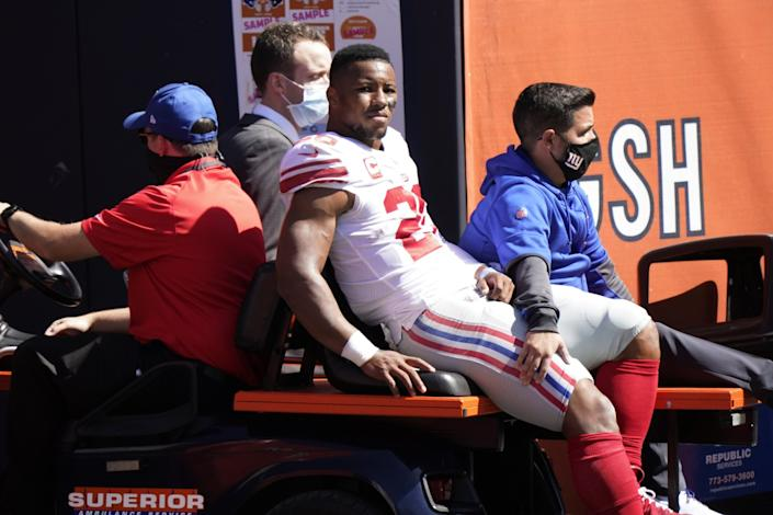 The Giants' Saquon Barkley is carted to the locker room after being injured against the Bears on Sunday.