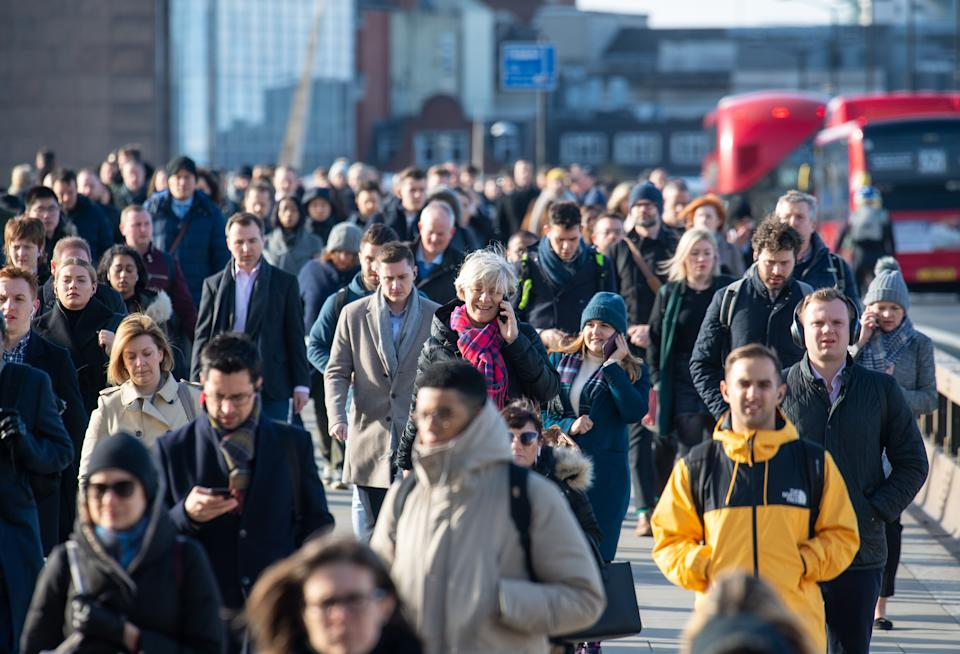 General view of commuters crossing London Bridge, in central London, during the morning rush hour, as the Government's top scientist warned that up to 10,000 people in the UK are already infected with Covid-19. (Photo by Dominic Lipinski/PA Images via Getty Images)