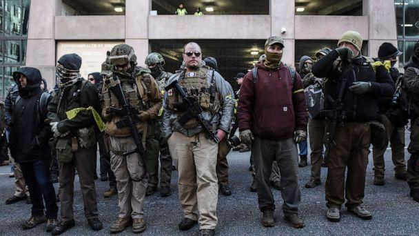 PHOTO: People who are part of an armed militia group arrive near the Virginia State Capitol building to advocate for gun rights in Richmond, Va. January 20, 2020. (Stephanie Keith/Reuters)