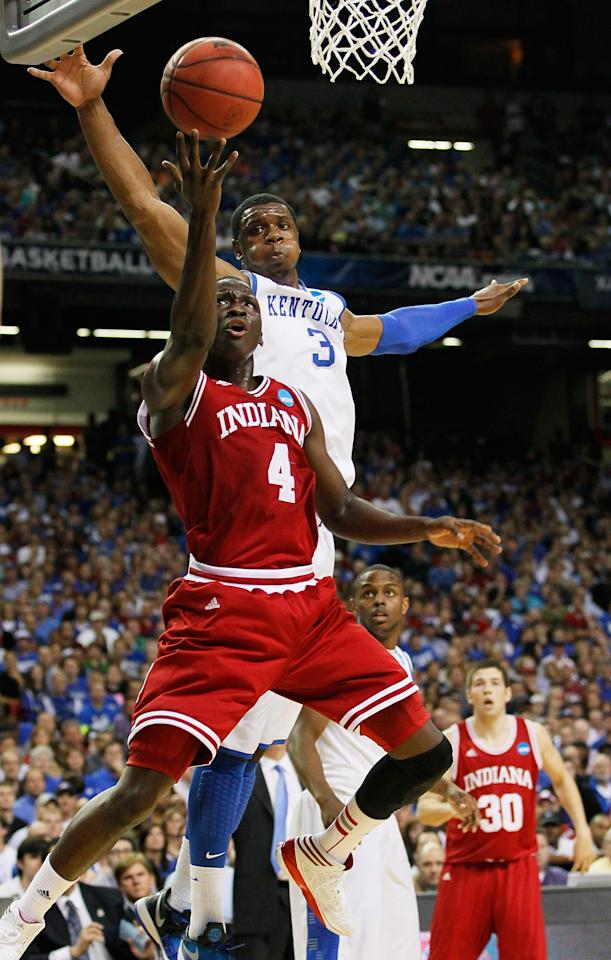 ATLANTA, GA - MARCH 23:  Victor Oladipo #4 of the Indiana Hoosiers shoots against the defense of Terrence Jones #3 of the Kentucky Wildcats in the first half during the 2012 NCAA Men's Basketball South Regional Semifinal game at the Georgia Dome on March 23, 2012 in Atlanta, Georgia.  (Photo by Kevin C. Cox/Getty Images)