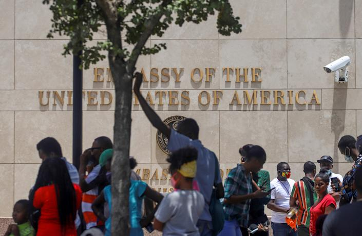 Haitians gather in front of the United States Embassy following the assassination of President Jovenel Moïse, in Port-au-Prince, Haiti, on July 9.