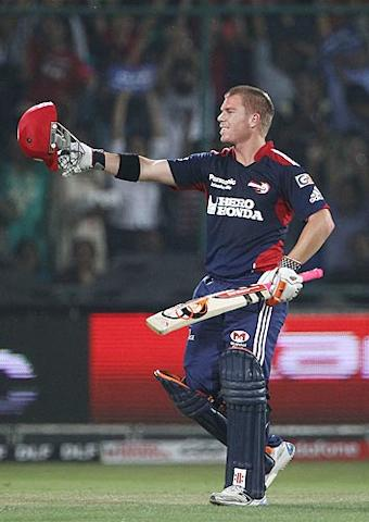 David Warner celebrates after scoring his century during the 2010 Indian Premier League T20 group stage match between Delhi Daredevils and Kolkata Knight Riders played at Feroz Shah Kotla Stadium in Delhi. (Getty Images)