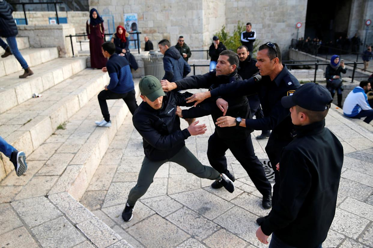 Israeli policemen scuffle with a Palestinian man during a protest near Damascus Gate in Jerusalem's Old City December 7, 2017.