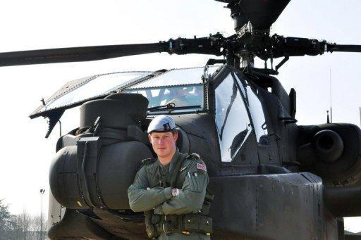 This photo, issued by Clarence House, shows Prince Harry standing in front of his Apache Helicopter in March 2011. Prince Harry could return to Afghanistan after he qualified as an Apache attack helicopter pilot with an award for his gunnery skills, the Ministry of Defence says