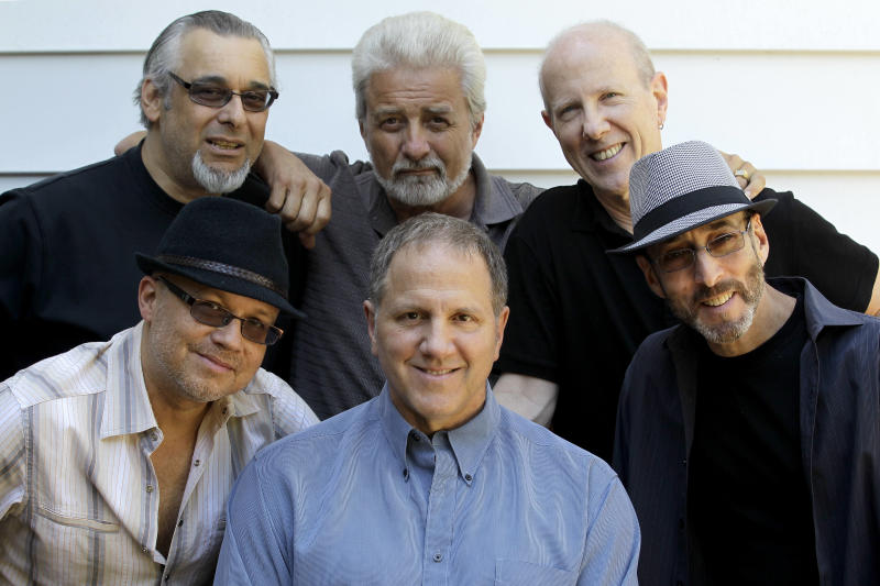 Members of the Four Seasons band, front from left: Russ Velasquez, Gary Polci, Larry Gates and rear from left Lee Shapiro, Don Ciccone and Jimmy Ryan pose for The Associated Press, Sunday, May 13, 2012 in Fair Lawn, N.J. Former members of the Four Seasons, minus lead singer Frankie Valli, have teamed up with some A-list studio musicians and have been rehearsing in Gates' basement in preparation for a nationwide tour. (AP Photo/Julio Cortez)