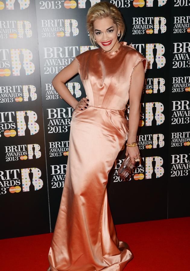 BRIT Awards 2013: Rita Ora opted for a peach satin gown with contrasting red lips at the event ©Getty