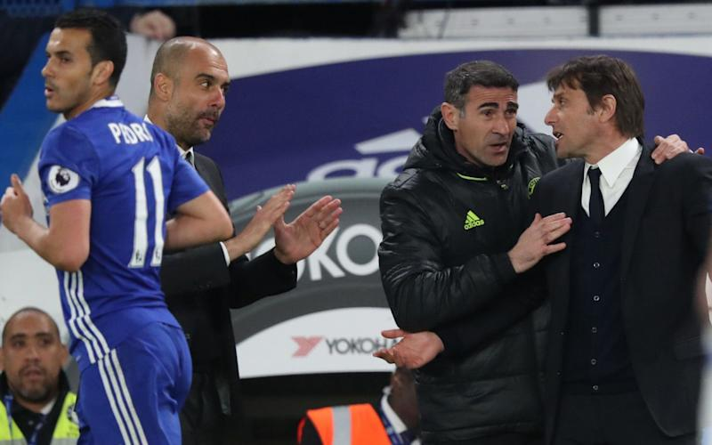 Antonio Conte and Pep Guardiola - Credit: BPI/Rex