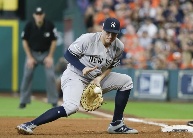 FILE - In this Oct. 14, 2017, file photo, New York Yankees' Greg Bird fields a grounder by Houston Astros' Brian McCann during the fifth inning of Game 2 of baseball's American League Championship Series in Houston. The Yankees plan to activate Bird from the disabled list before Saturday's game against the Los Angeles Angels, forcing New York to make a difficult roster decision. Bird has been sidelined since right ankle surgery on March 27. (AP Photo/Tony Gutierrez, File)