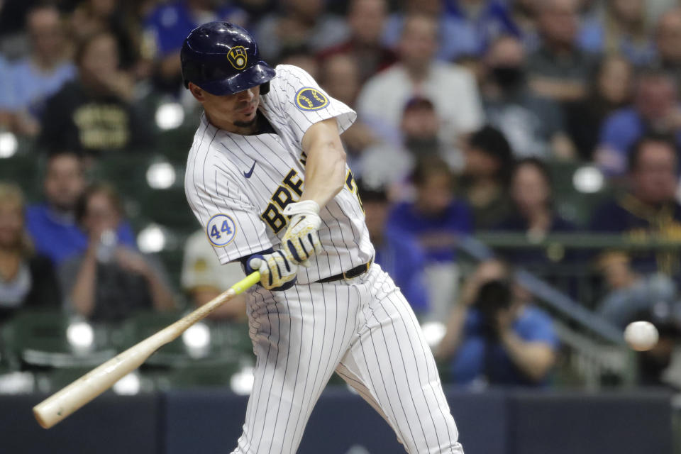 Milwaukee Brewers' Willy Adames hits a two-run home run during the third inning of a baseball game against the New York Mets, Friday, Sept. 24, 2021, in Milwaukee. (AP Photo/Aaron Gash)