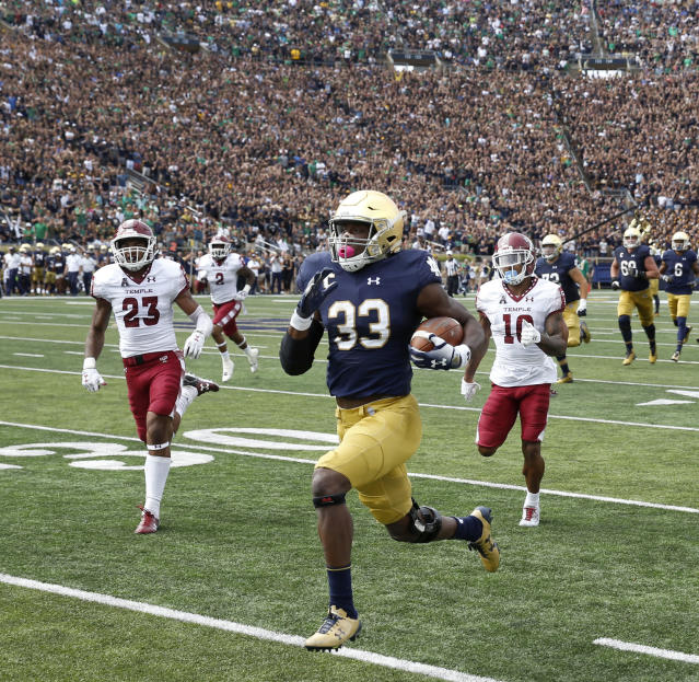 Notre Dame running back Josh Adams (33) has seven 100-yard rushing games this season. (AP Photo/Charles Rex Arbogast)