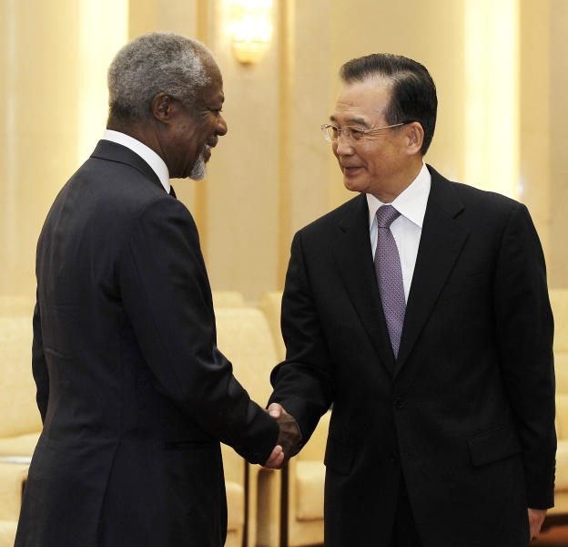 Former U.N. Secretary General Kofi Annan, left, is greeted by Chinese Premier Wen Jiabao during their meeting at the Great Hall of People in Beijing on Tuesday, March 27, 2012. Syria accepted a peace plan by Annan, which includes a cease-fire by Syrian forces and a daily two-hour halt to fighting to evacuate the injured, Annan's spokesman said Tuesday. (AP Photo/Lintao Zhang, Pool)