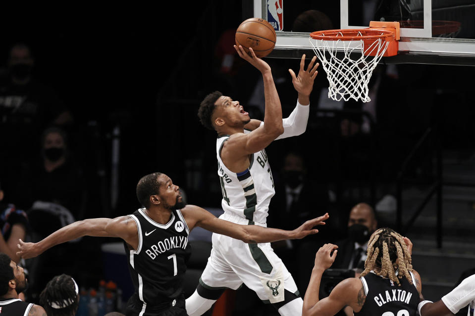 Milwaukee Bucks forward Giannis Antetokounmpo (34) drives to the basket past Brooklyn Nets forward Kevin Durant (7) during Game 1. (AP Photo/Adam Hunger)