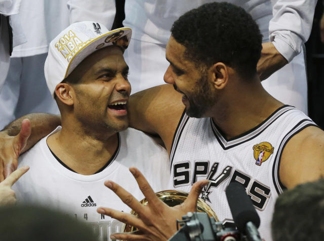 San Antonio Spurs guard Tony Parker, left, and forward Tim Duncan celebrate after Game 5 of the NBA basketball finals on Sunday, June 15, 2014, in San Antonio. The Spurs won the NBA championship 104-87. (AP Photo/David J. Phillip)