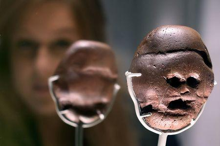 "The Makapansgat pebble is seen on display as part of the exhibition ""South Africa: the Art of a Nation"", at the British Museum in London"