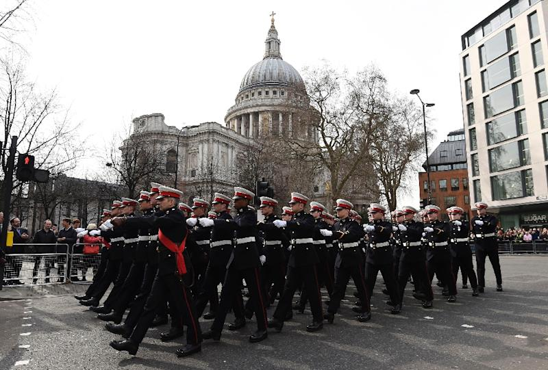Members of the Royal Marines march past St Paul's Cathedral in central London on March 13, 2015