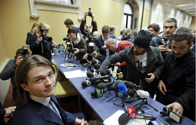 Raffaele Sollecito (L) looks on as he arrives to lead a news conference in Rome March 30, 2015. Italy's top court on Friday annulled the conviction of American Amanda Knox for the 2007 murder of British student Meredith Kercher and, in a surprise verdict, acquitted her of the charge. The Court of Cassation threw out the second guilty verdict to have been passed on Knox, 27, and her Italian former boyfriend Raffaele Sollecito for the lethal stabbing. REUTERS/Max Rossi