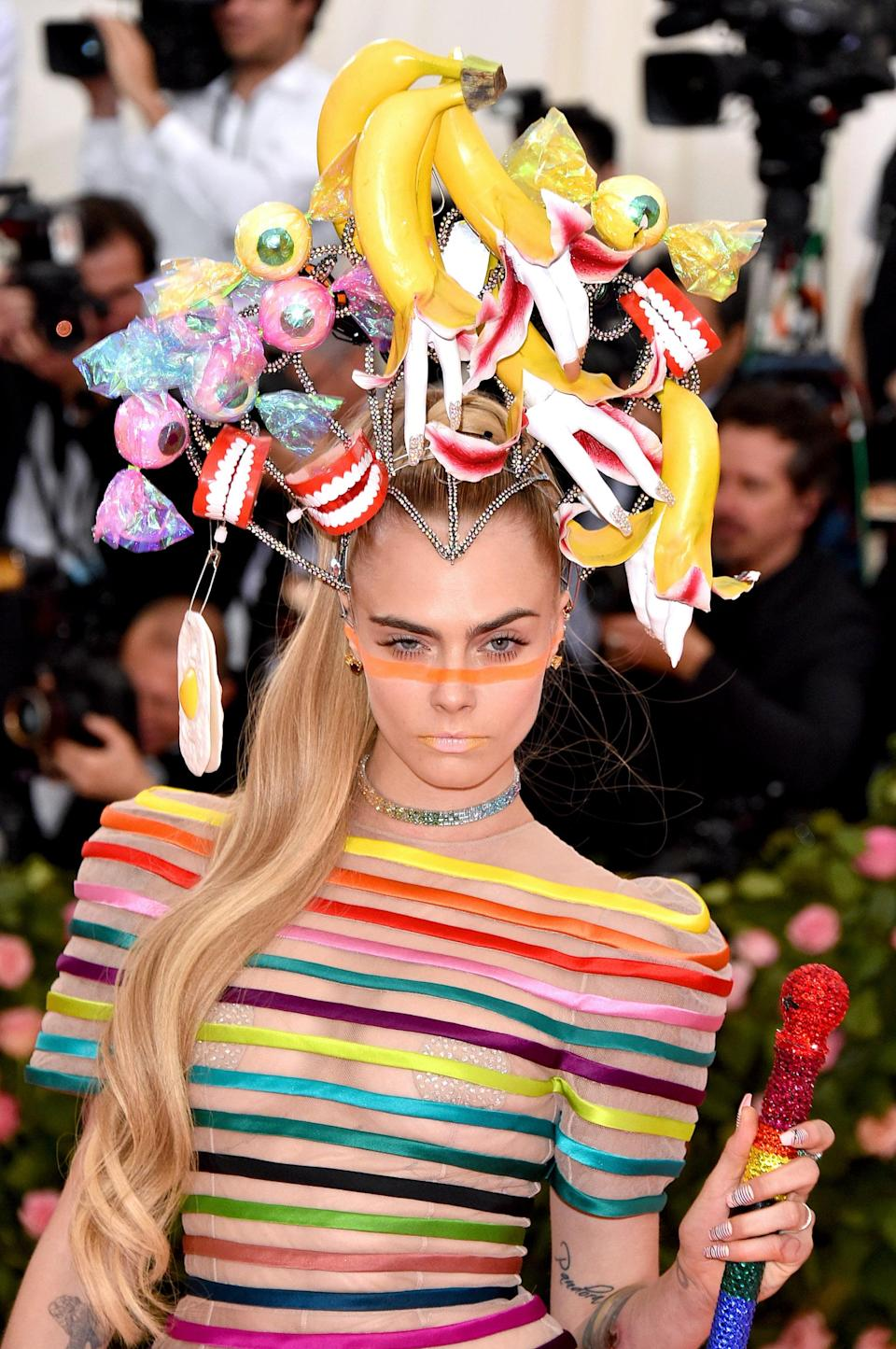 """<p>Once you register everything that's going on with <a href=""""https://www.popsugar.co.uk/fashion/photo-gallery/46115228/image/46122675/Cara-Delevingne-2019-Met-Gala"""" class=""""link rapid-noclick-resp"""" rel=""""nofollow noopener"""" target=""""_blank"""" data-ylk=""""slk:Delevingne's over-the-top headpiece at the 2019 Met Gala"""">Delevingne's over-the-top headpiece at the 2019 Met Gala</a>, make sure you look down at her waist-length ponytail - a style we don't often seem from the star.</p>"""