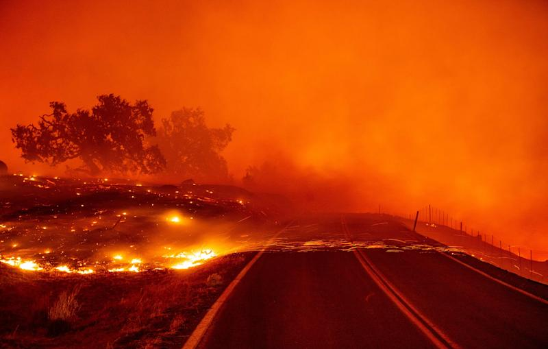 Embers blow across a road during the Kincade fire near Geyserville, Calif. on Oct. 24, 2019.