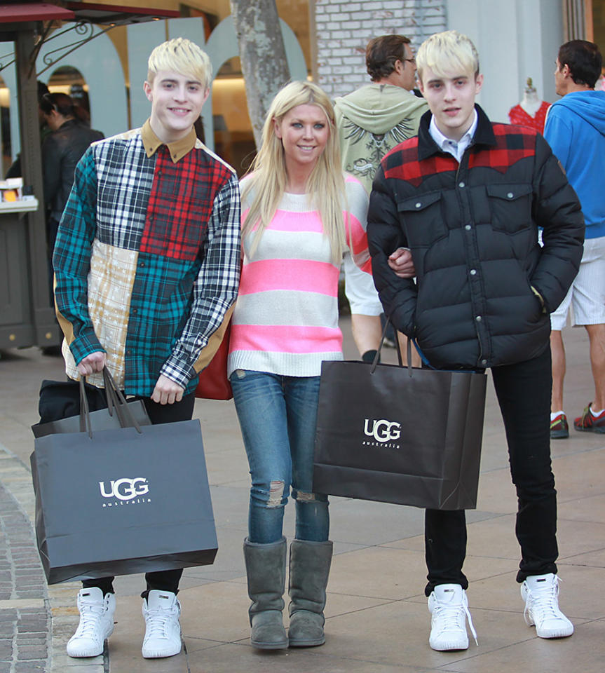 "Now <em style=""mso-bidi-font-style: normal;"">this</em> is an interesting trio. British pop stars John Grimes and Edward Grimes -- better known as Jedward -- enjoyed a shopping spree with the fallen-off-the-radar ""American Pie"" actress Tara Reid at Los Angeles mall The Grove, where they picked up some of Tara's favorite footwear ... UGGs! The three are old pals from their stint on Britain's version of ""Celebrity Big Brother."" Either Jedward or Tara has a loyal fanbase, since omg! users voted via <a href=""http://twitter.com/yahooomg"" target=""_blank"">Twitter</a> on Wednesday to include this pic in today's Top Shots of the Week update. We're guessing the fans belong to Jedward!"