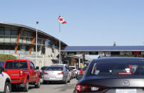 In this Oct. 9, 2019 photo, traffic enters Canada from the United States at the Peace Arch Border Crossing, in Blaine, Wash. The Washington state chapter of the Council on American-Islamic Relations says more than 60 Iranians and Iranian-Americans were detained and questioned at the border crossing over the weekend. A U.S. Customs and Border Protection spokesman, however, said no Iranian-Americans were detained or refused entry because of their country of origin. (AP Photo/Elaine Thompson)