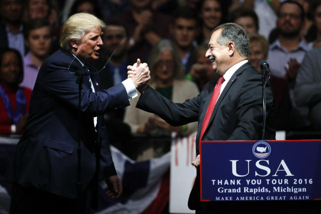 Then-President-elect Donald Trump thanks Dow Chemical CEO Andrew Liveris in December 2016. (Photo: Paul Sancya/AP)