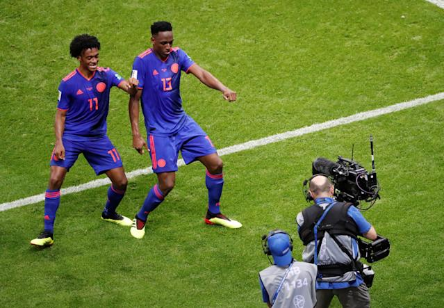 Soccer Football - World Cup - Group H - Poland vs Colombia - Kazan Arena, Kazan, Russia - June 24, 2018 Colombia's Yerry Mina celebrates scoring their first goal with Juan Cuadrado REUTERS/Jorge Silva