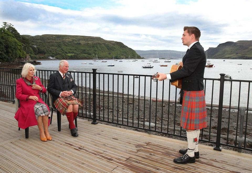 Gaelic singer, Robert Robertson, entertains the Prince of Wales and Duchess of Cornwall, known as the Duke and Duchess of Rothesay when in Scotland, during their visit to Portree (William Urquhart/PA) (PA Wire)