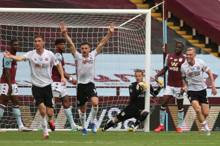 Sheffield United were denied a goal even  though  Aston Villa's Orjan Nyland carried the ball over the line