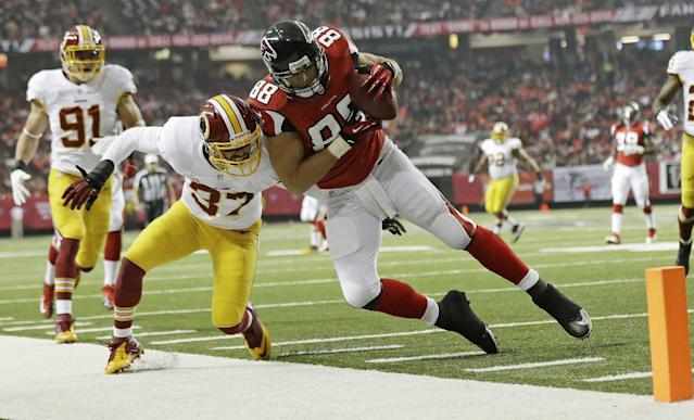 Atlanta Falcons tight end Tony Gonzalez (88) makes a catch against Washington Redskins strong safety Reed Doughty (37) during the first half of an NFL football game, Sunday, Dec. 15, 2013, in Atlanta. (AP Photo/John Bazemore)