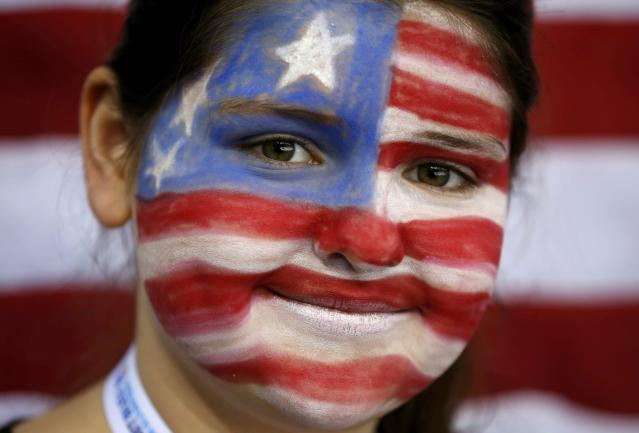 A fan with her face painted in the colours of the U.S. flag attends the women's preliminary round hockey game between Team USA and Switzerland at the Sochi 2014 Winter Olympic Games February 10, 2014.women's ice hockey at the Sochi 2014 Sochi Winter Olympics February 10, 2014. REUTERS/Jim Young (RUSSIA - Tags: SPORT ICE HOCKEY OLYMPICS HEADSHOT)