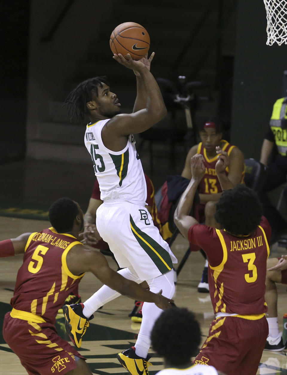 Baylor guard Davion Mitchell (45) scores between Iowa State defenders Jalen Coleman-Lands (5) and Tre Jackson (3) in the first half of an NCAA college basketball game, Tuesday, Feb. 23, 2021, in Waco, Texas. (AP Photo/Jerry Larson)