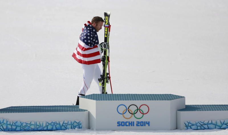 United States' Bode Miller walks to the podium after winning the joint bronze medal in the men's super-G at the Sochi 2014 Winter Olympics, Sunday, Feb. 16, 2014, in Krasnaya Polyana, Russia. (AP Photo/Gero Breloer)
