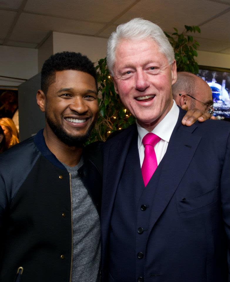 "President Clinton and <a target=""_blank"" href=""http://news.yahoo.com/photos/usher-performs-at-decade-of-difference-concert-1318751750-slideshow/"">Usher</a> before ""A Decade of Difference"" concert.<br><br>(Photo by Barbara Kinney / Clinton Foundation)"