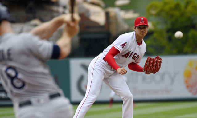 Tampa Bay Rays' Joey Wendle, left, grounds out as Los Angeles Angels starting pitcher Shohei Ohtani, of Japan, watches during the third inning of a baseball game Sunday, May 20, 2018, in Anaheim, Calif. (AP Photo/Mark J. Terrill)