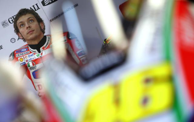 Ducati Team's Italian Valentino Rossi looks on inside the pit during the Moto GP Training session of the Valencia Grand Prix at Ricardo Tormo racetrack in Cheste, on November 9, 2012. AFP PHOTO/ JOSE JORDANJOSE JORDAN/AFP/Getty Images